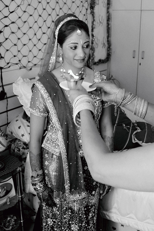 Bride being blessed by her mother